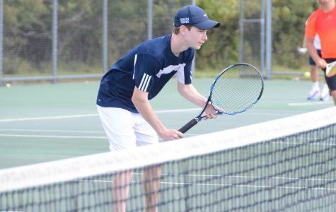 Varsity tennis team defeats North