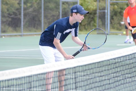 Varsity tennis team defeats North