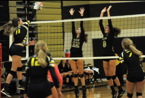 Varsity volleyball gains victory over rival