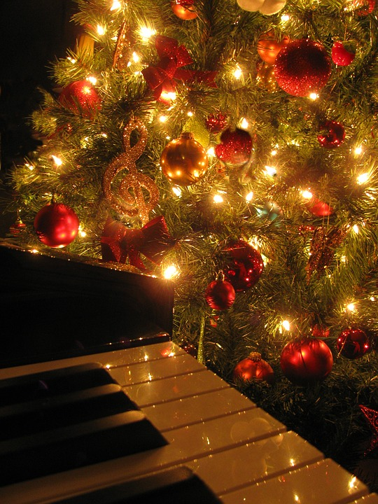 A Christmas tree with a piano. Holiday-themed music will be played at tonight's concert.