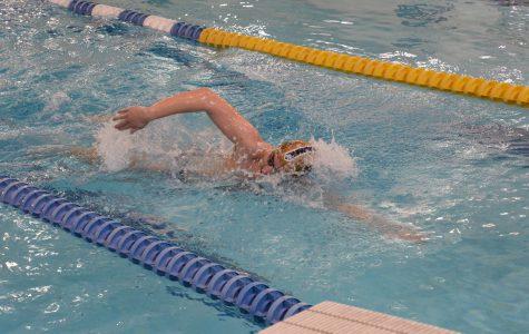 Boys varsity swimming team participates in college level scrimmage