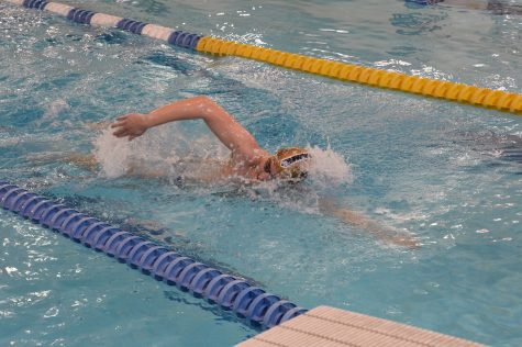 Boys varsity swimming team participates in college level scrimmage