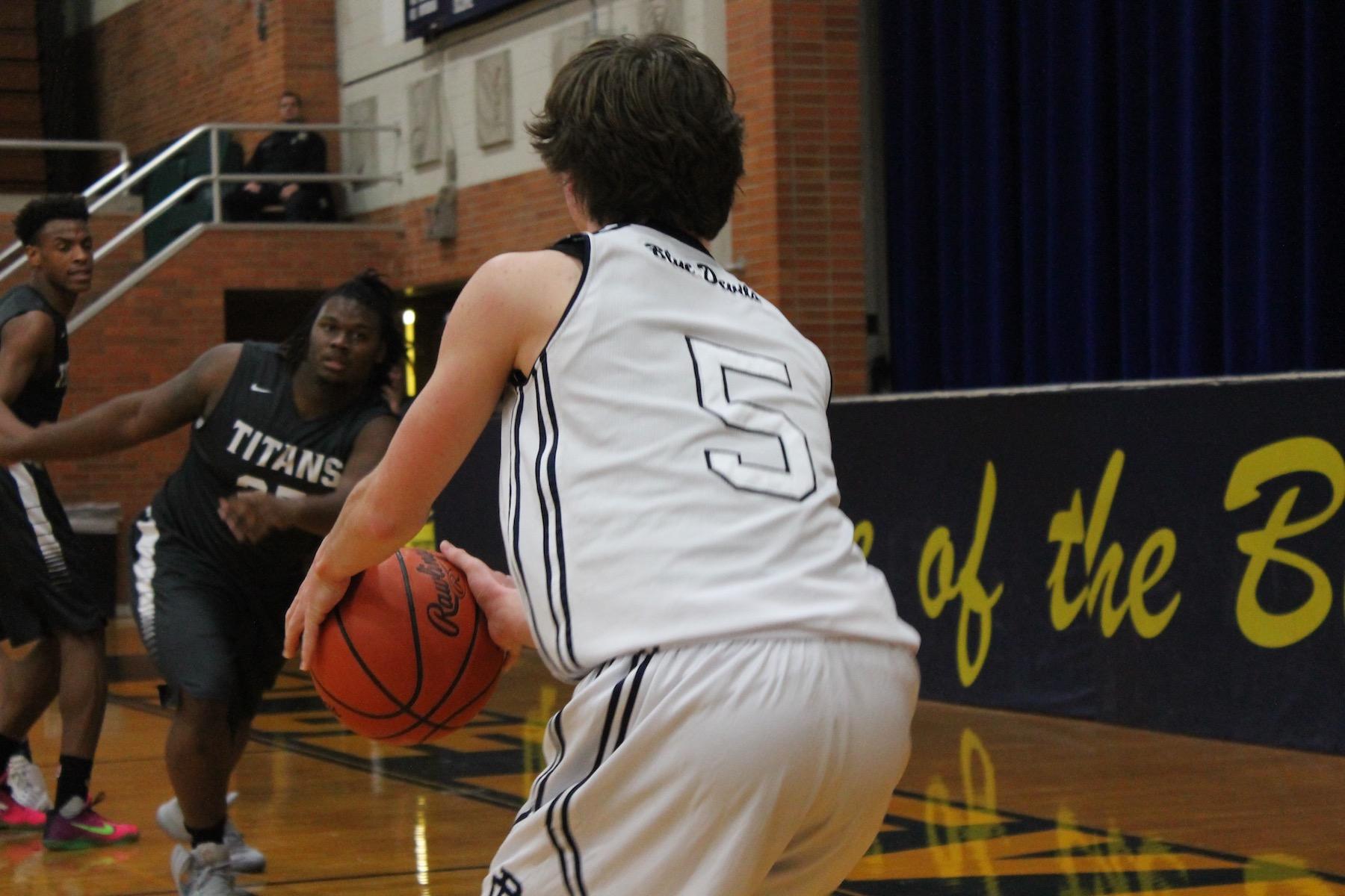 Boys varsity basketball team plays against Utica Stevenson.