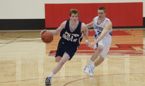 Men's varsity basketball team defeats Lakeview in first round of playoffs
