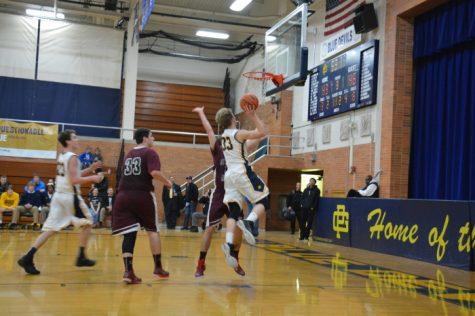 Boys basketball serves it up to Fraser 65-41