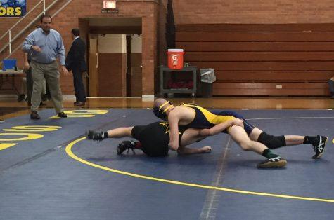 Boys wrestling wins MAC Championship, two athletes advance