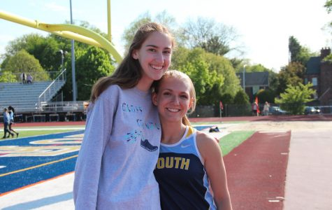 Emma Edwards '17 with runner Hadley Diamond '16.  Both girls play roles in the track and cross country teams.