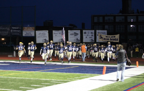 Football team wins first playoff game handily