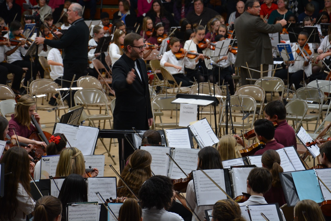 James Gross, South's Orchestra Director, directs the orchestra at the String Extravaganza.