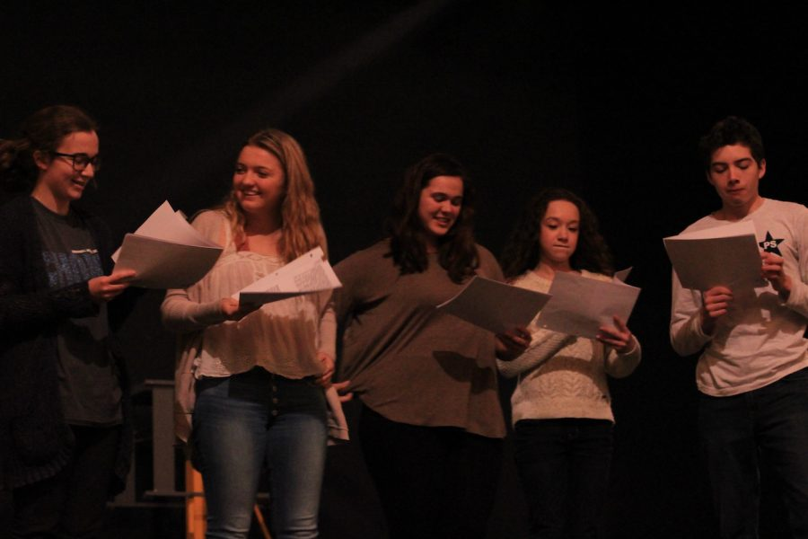 A group of students running lines for One Acts. One Acts are student-directed productions with only one act each.