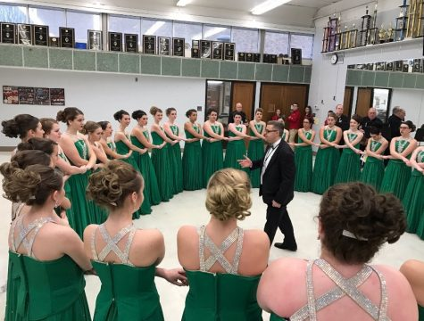 The South choir in a circle before their competition in Findlay, Ohio Friday.