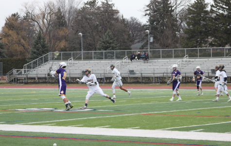 The boys varsity lacrosse team fell 15-1 to Catholic Central in their first game of the season. Photo by Alyssa Czech '19.