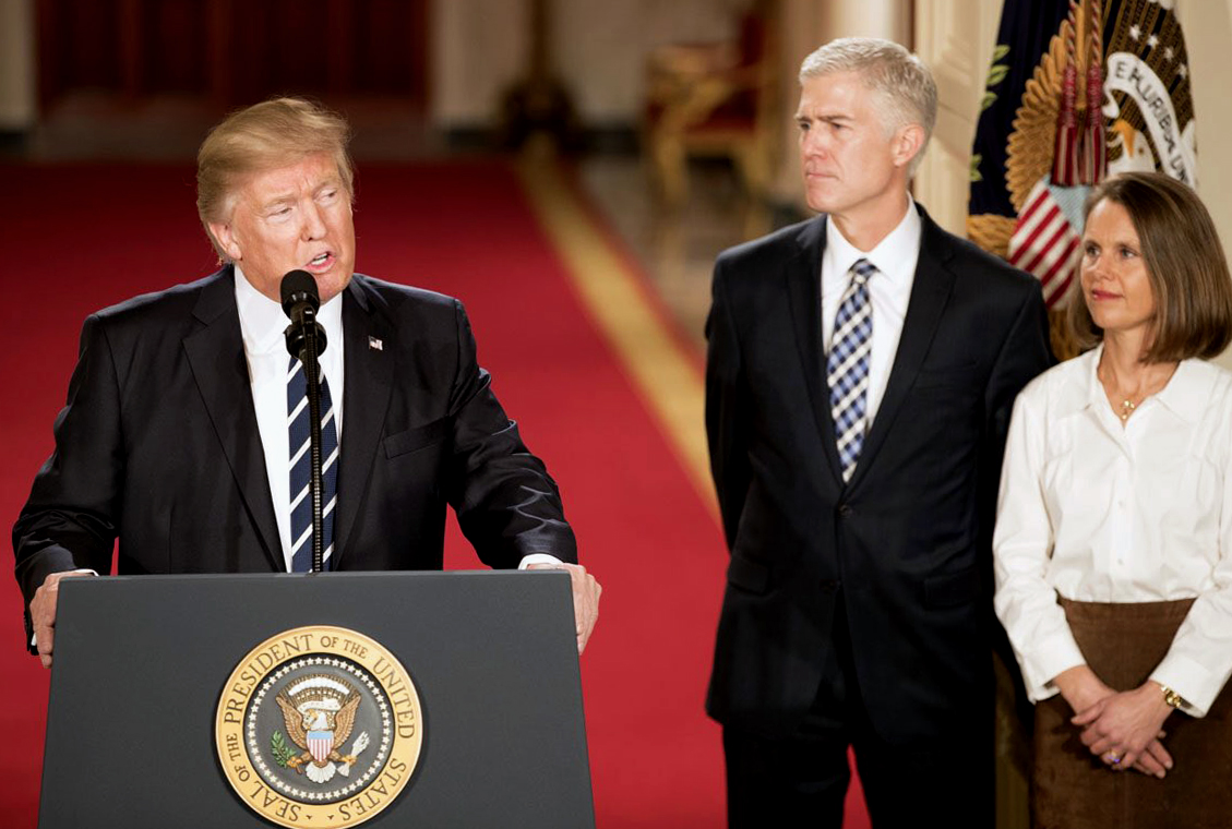 Donald Trump speaking next to his Supreme Court nominee, Neil Gorsuch. Gorsuch was confirmed as the newest justice on April 10.