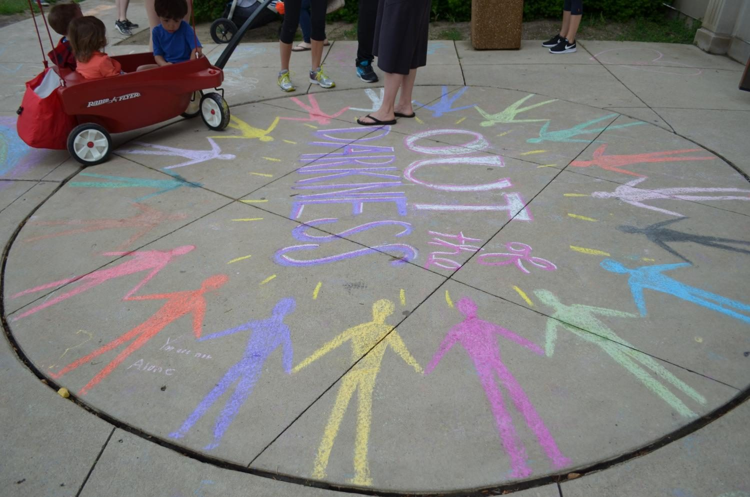 Gen Boyle '17 created chalk illustrations outside the Boll Center where the walk began. The drawings had themes of unity, love and positivity.