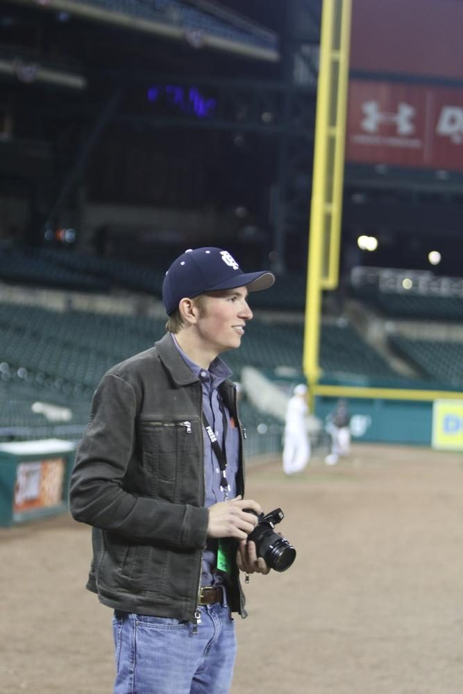 John+Francis+%2718+taking+photos+during+the+Varsity+Baseball+Game+vs.+Grosse+Pointe+North+at+Comerica+Park.+