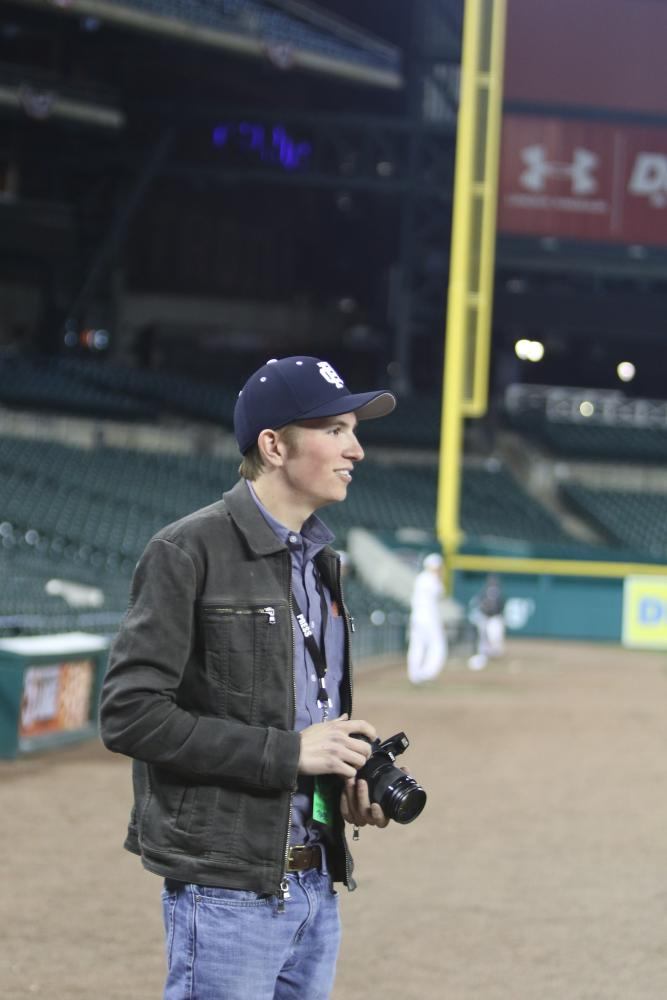 John Francis '18 taking photos during the Varsity Baseball Game vs. Grosse Pointe North at Comerica Park.