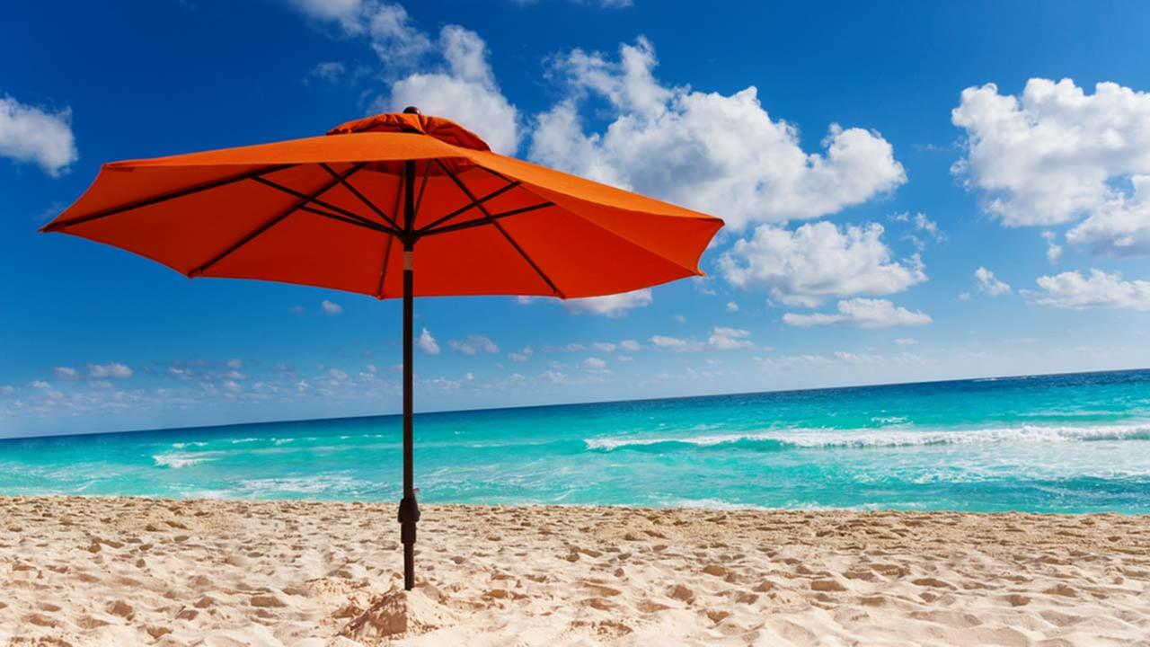 Always make sure to have an umbrella on the beach. Photo from Google Images.