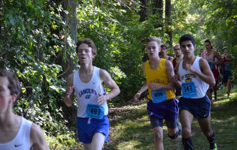 Isaac Kado (far right) is a captain and one of the fastest runners on the boys' cross country team. Here he is shown racing at the Algonac Muskrat Classic, where he finished seventh for the Blue Devils.
