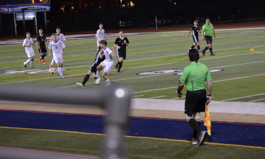Senior+Peter+Hummer+tackles+an+opposing+player+from+Lanse+Creuse+at+a+home+game.