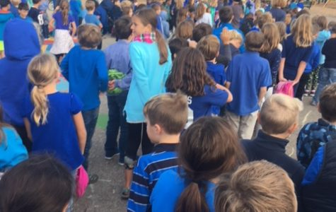 "Students gathered outside to form a giant ""M"" to celebrate Maire's Blue Ribbon Award."