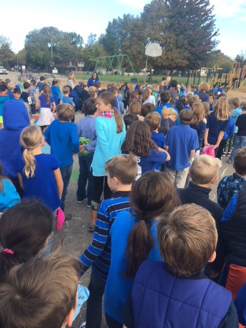 Students+gathered+outside+to+form+a+giant+%E2%80%9CM%E2%80%9D+to+celebrate+Maire%E2%80%99s+Blue+Ribbon+Award.+