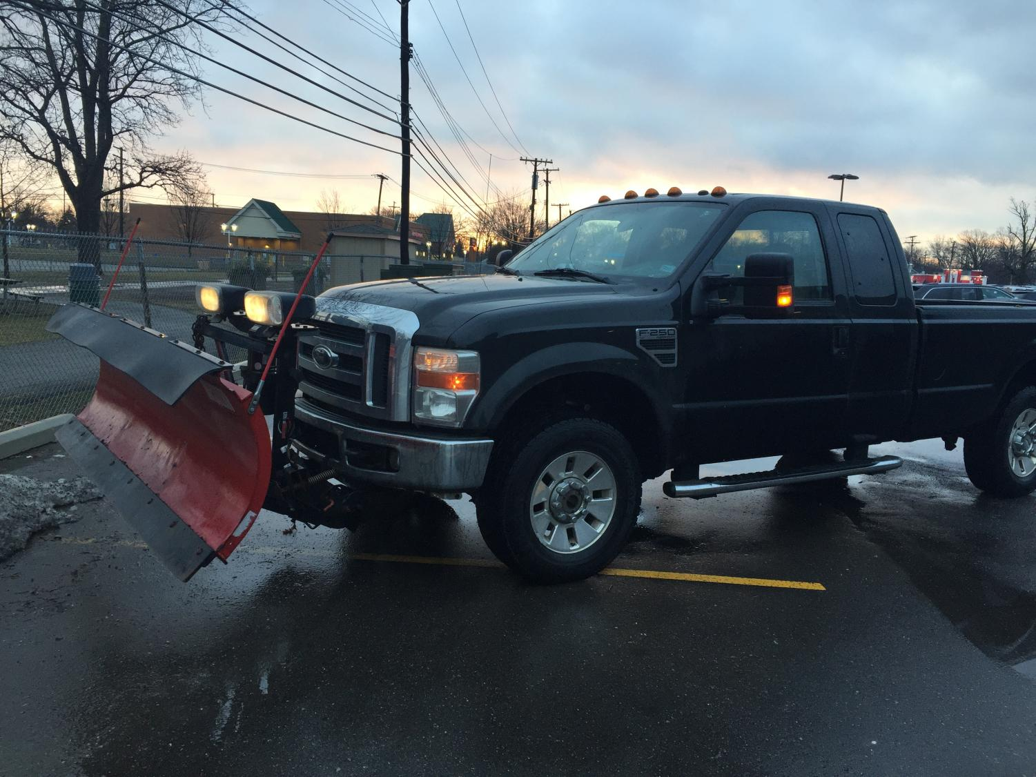 Morgan Mathews is the owner of a landscaping business which plows snow in the winter with trucks like these. Photo courtesy of Chase Clark '18
