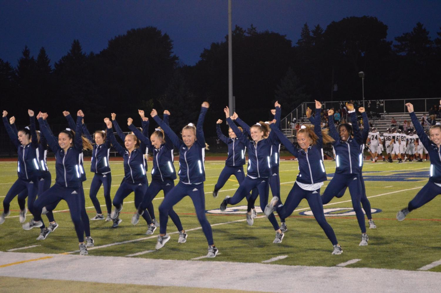 The new dance team performs for the first time during halftime of the varsity football game on Sept. 7. Photo by Olivia Mlynarek '19