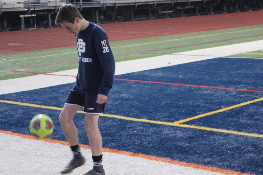 Michael Tengler 22 warms up for an important practice the day before South's district playoff game against Fordson.