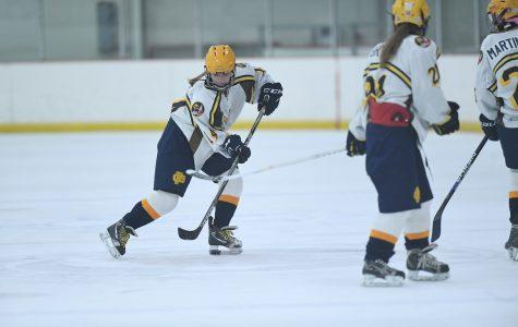 Action shot of the girls hockey last season. Photo courtesy of Lauren Kramer.