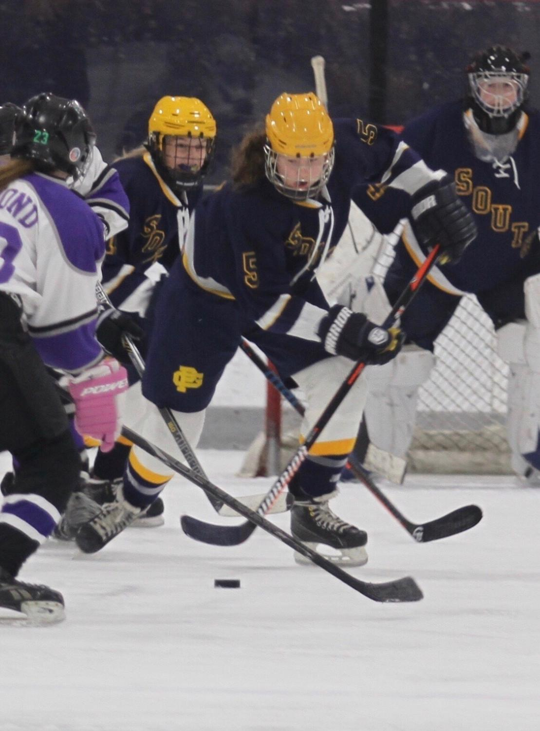 Tory Roth '22 breaks the puck out of her zone during a recent hockey game. Photo Courtesy of Roth.