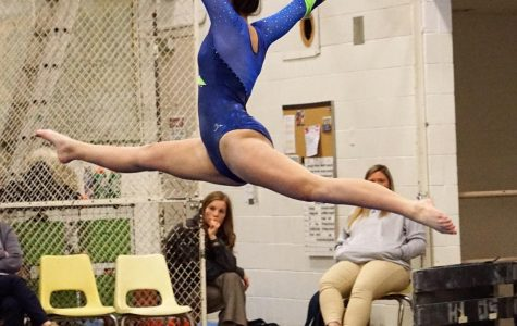 Kate Ennis '21 has been doing gymnastics for six years. Photo by Hope Whitney '21.