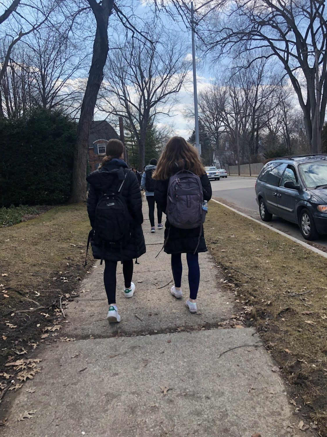 Students walk to school in the cold. Spring starts Mar. 20, something many South students who brave the cold to get to school are looking forward to.