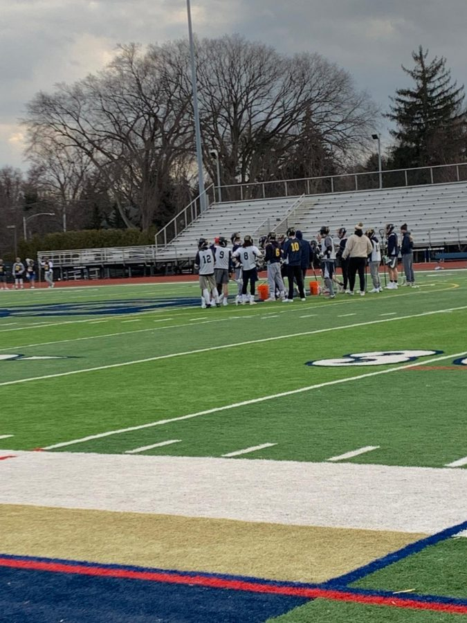 Coach+Justin+Macksound+gathers+the+offensive+unit+in+between+drills.+The+team+spends+a+lot+of+time+working+on+offense+at+practice.
