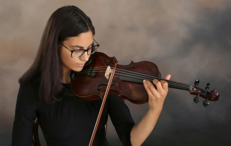 Anna Jarboe '19 practices her violin. She heads to the Peabody Institute at Johns Hopkins University to study violin performance this Fall. Photo courtesy of Jarboe.