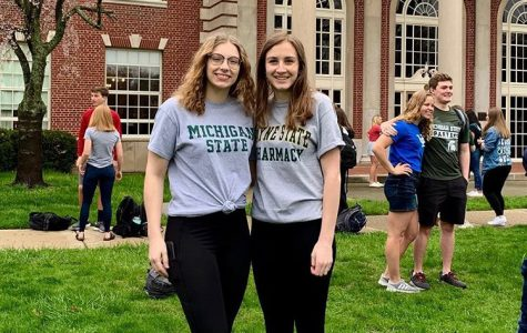 Emma Kniivila '19 poses on the front lawn for decision day with Mary Malbouef '19. Kniivila will be studying organic chemistry.  Photo courtesy of Emma Kniivila '19.