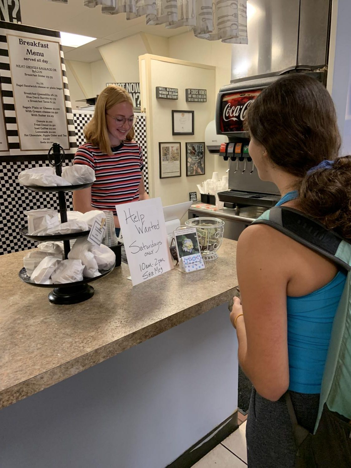 Abbey Homminga '21 assisting a customer during her morning shift at Hydrangea Kitchen.