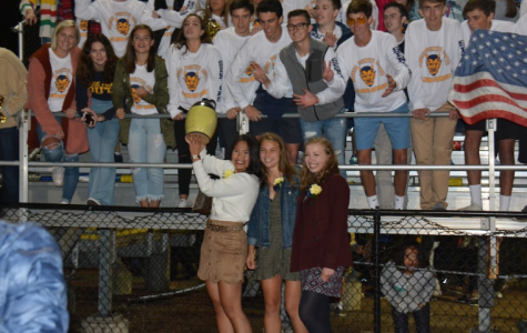Members of the senior class of 2019 raise the spirit jug at the homecoming game last year. This year, the spirit  jug competition includes a new category  for school involvement. Photo by Just-Us Welch '20.