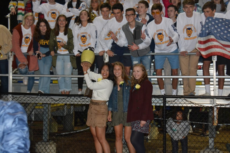 Members+of+the+senior+class+of+2019+raise+the+spirit+jug+at+the+homecoming+game+last+year.+This+year%2C+the+spirit++jug+competition+includes+a+new+category++for+school+involvement.+Photo+by+Just-Us+Welch+%2720.