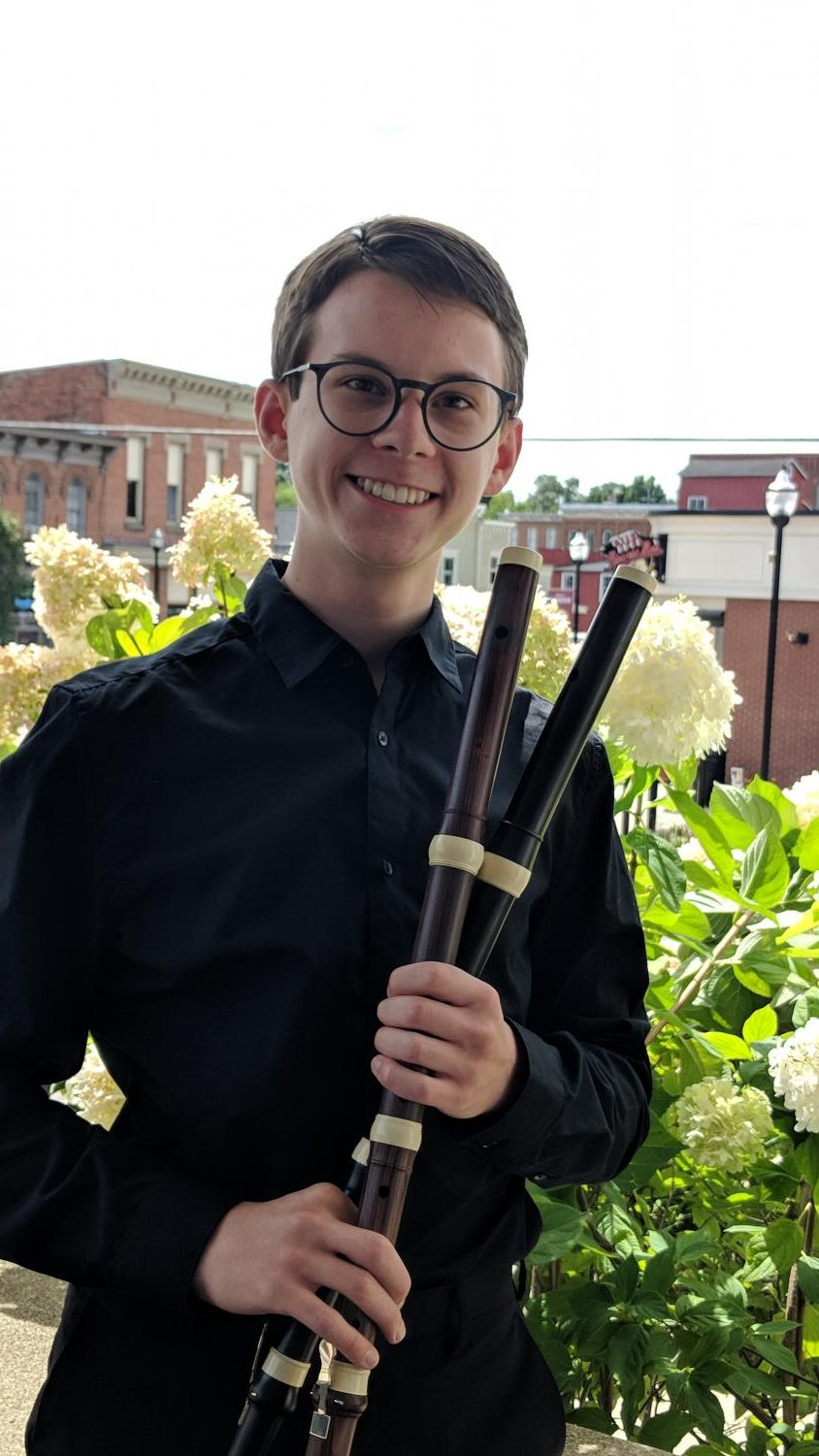 Ian Plansker '20 stands with his flutes. Plansker is graduating two years early to pursue his music career. Photo courtesy of Plansker.
