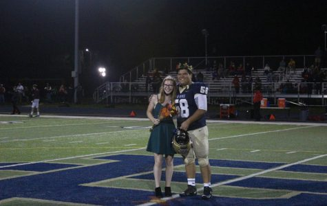 Lizzie High and Owen Chen, both '20 are crowned Homecoming queen and king at the football game on Sept. 27. One of the new changes this year to Homecoming was incorporating male members of Homecoming court from every grade. Photo by Zach Farrell '21.
