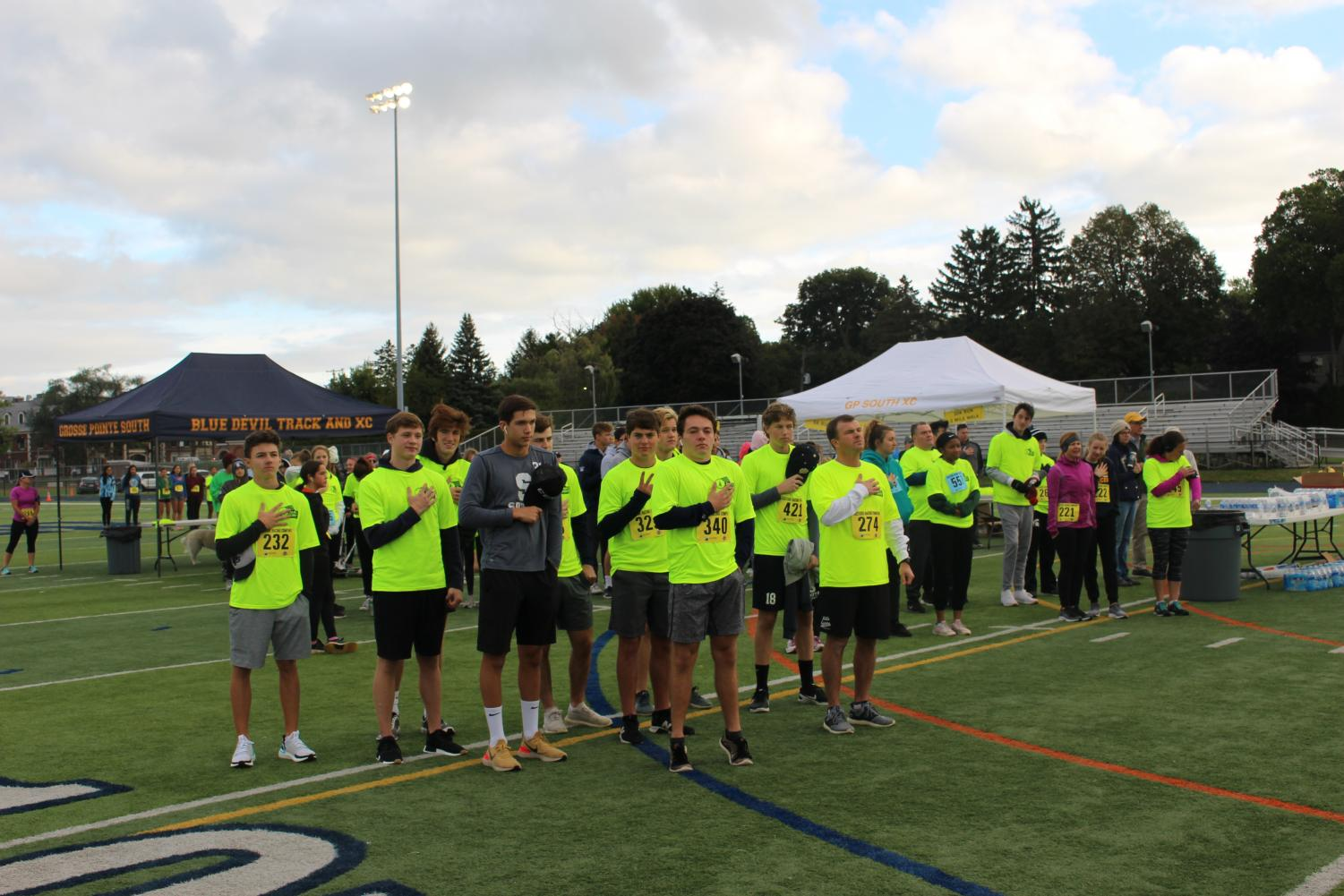 Representatives from almost every Varsity sports team at South came out on Saturday morning in support of GPS Athletics. Here, the Blue Devil Hockey team stands for the National Anthem moments before the start of the first race of the day: the 10k.