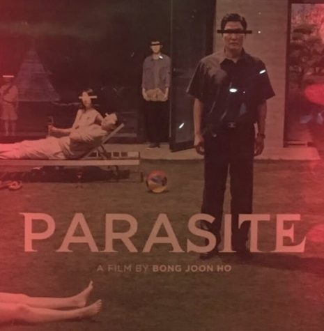 Bong Joon-Ho's newest movie, Parasite, is in theaters now. Photo of movie poster by Abi Wilson '20.