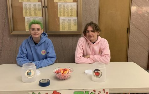 Club members run the fundraising table during lunch Dec. 11. The fundraiser runs Dec. 9-13. Photo by Nina Simon '21.
