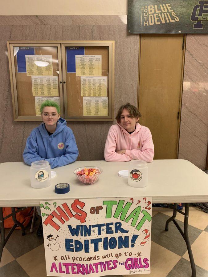 Club members run the fundraising table during lunch Dec. 11. The fundraiser runs Dec. 9-13. Photo by Nina Simon '21.