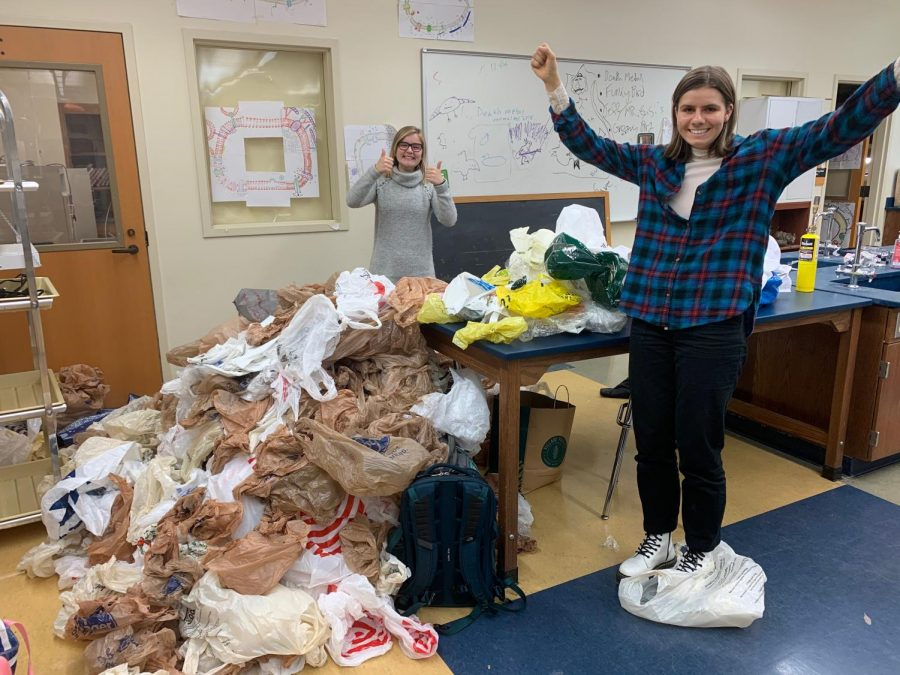 Save the Lake club members Emily Esmacher and Ally Vern, both '20, pose with the 1400 bags they collected to make mats for the homeless. Photo by Nina Simon '21.