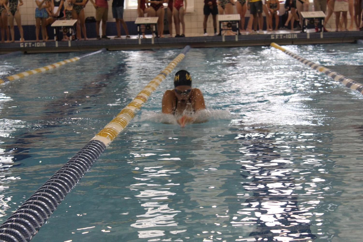 Swimmers compete in the breast stroke at a home meet. The Blue Devils took second at states on Nov. 23. Photo by Keely Messacar '21.