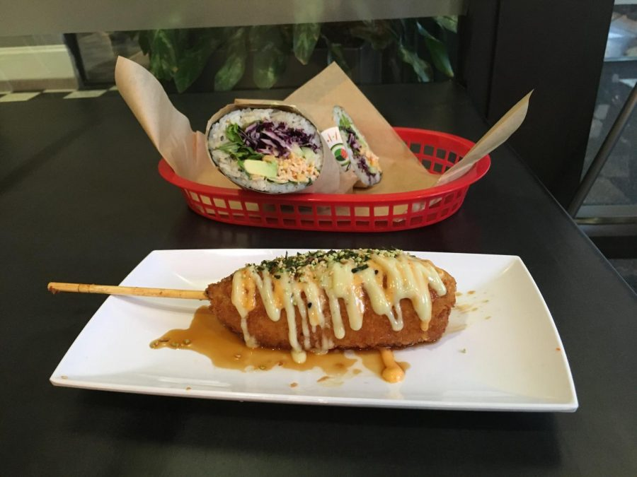 The make-your-own burrito sushi roll, pictured here with vegetables and spicy mayonnaise, can be customized to order. Also pictured here is a sushi corn dog. Photos by Nina Simon '21 and Gaby Dulworth '22.