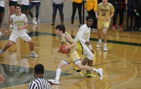 Boys basketball overwhelms rivals on the road