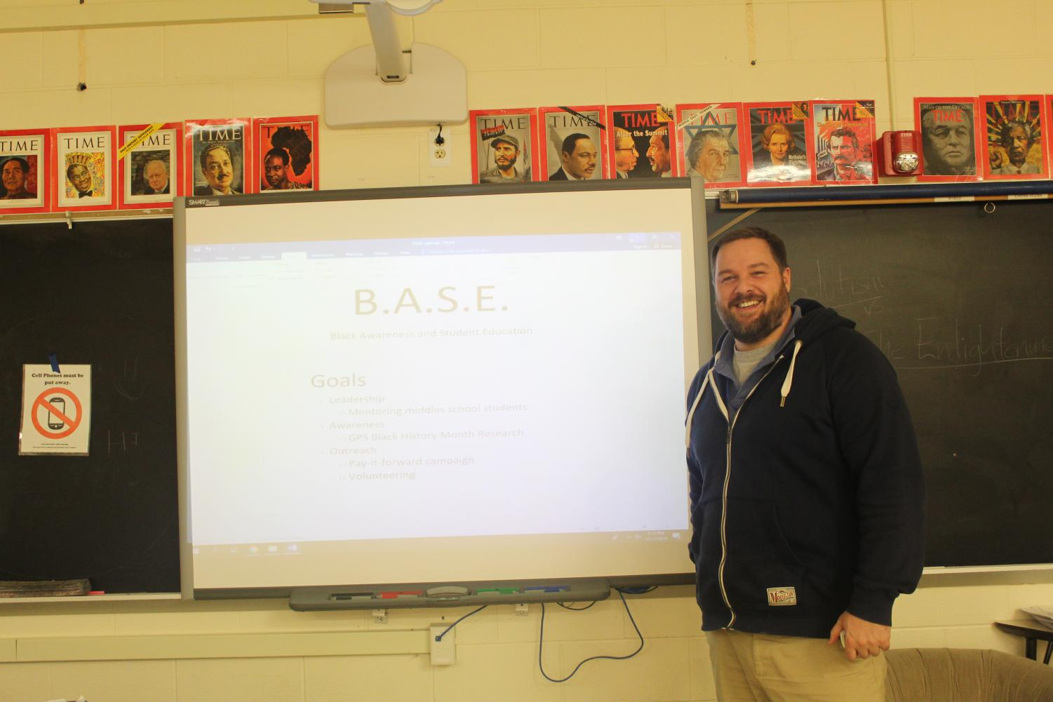 Kevin Minor stands with the first slides for the newly revived BASE club. He will serve as lead club sponsor. Photo by Andrew Acker '21.