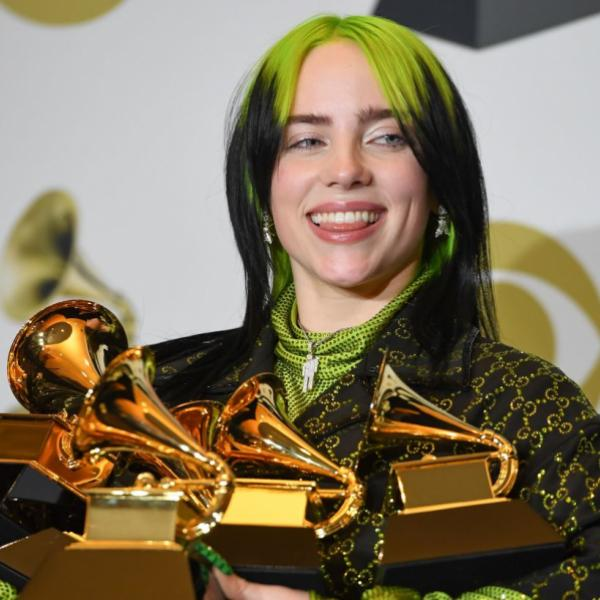 Billie Eilish, pictured with the five Grammys she won. Photo courtesy of grammy.com